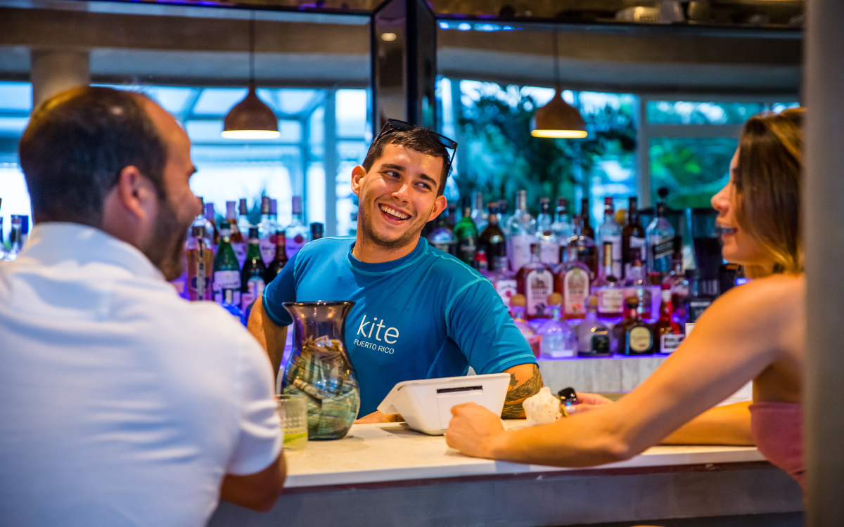 Bartender talking with patrons